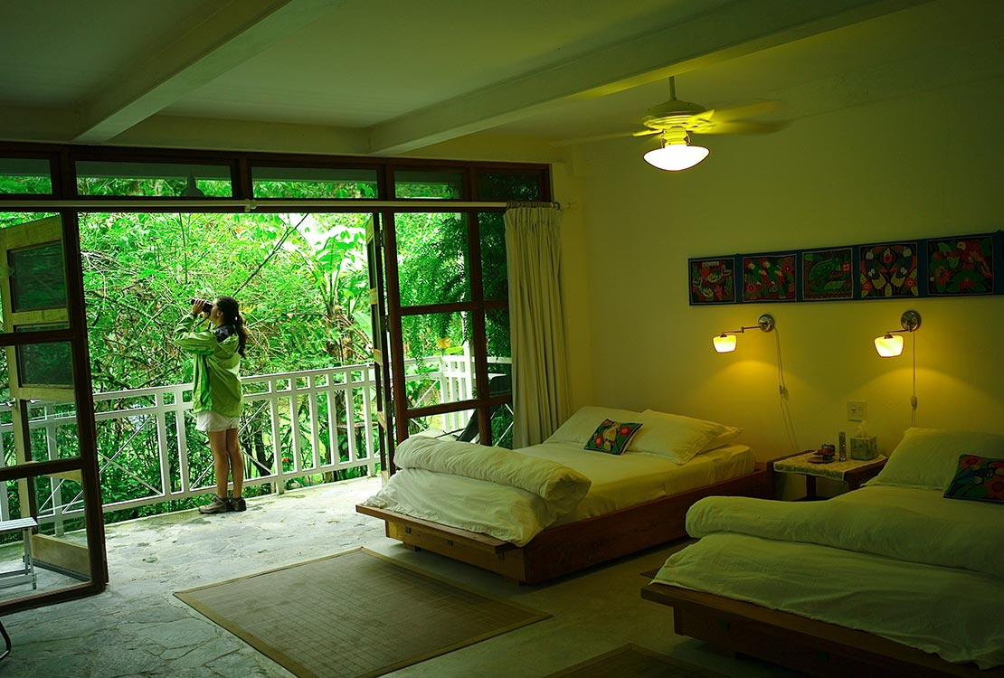 Canopy Lodge accommodations, woman on balcony