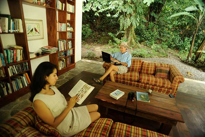 Visitors to Canopy Lodge enjoying the library