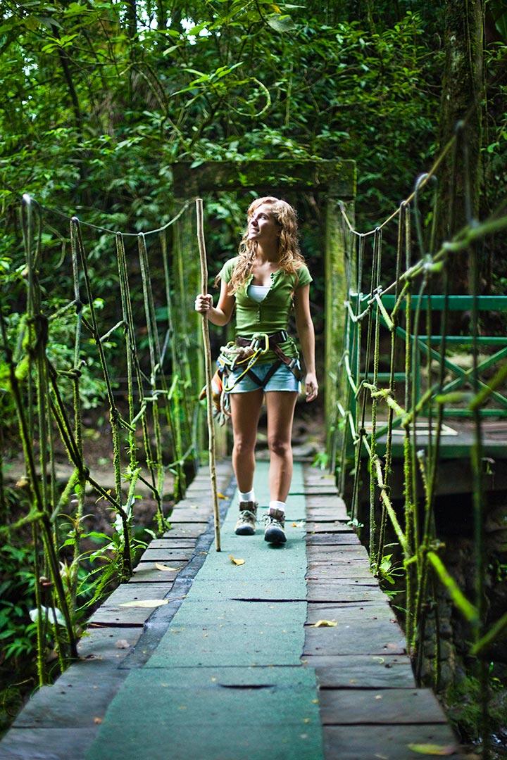 Woman walking over suspension bridge Canopy Adventure Panama